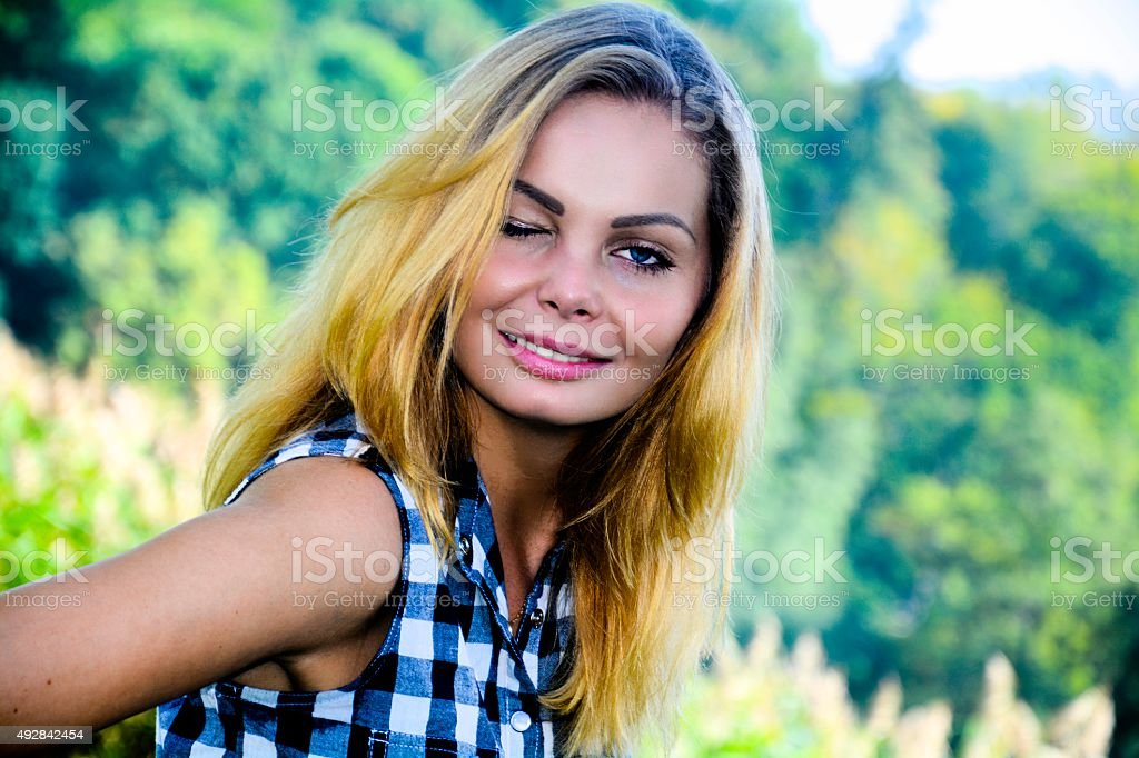 Winking young girl stock photo