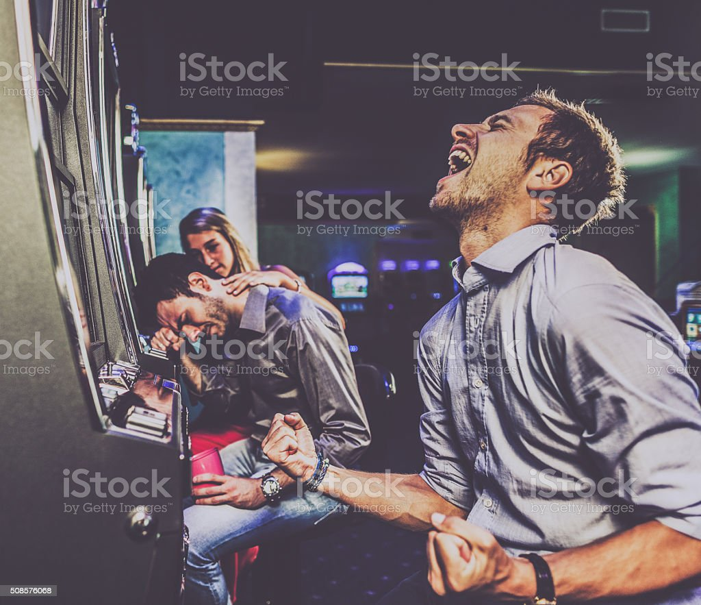 Winner and loser at casino stock photo
