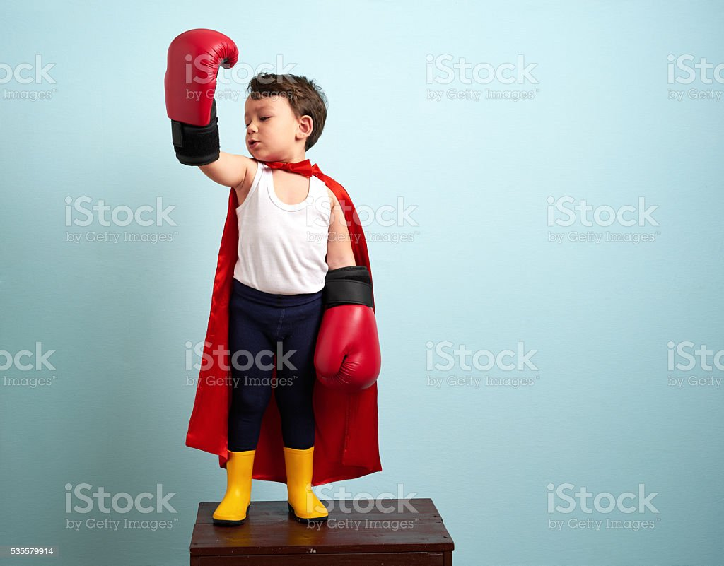 Winner boxer child raising his hands with victory stock photo