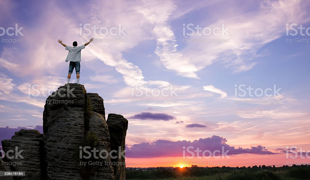 Winner man standing on the top of mountain panoramic view stock photo