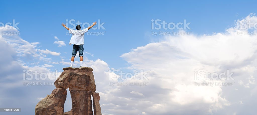 Winner man standing on the top of mountain stock photo