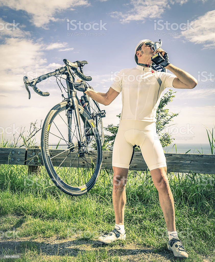 Winner of a Bike Race kisses the Trophy royalty-free stock photo
