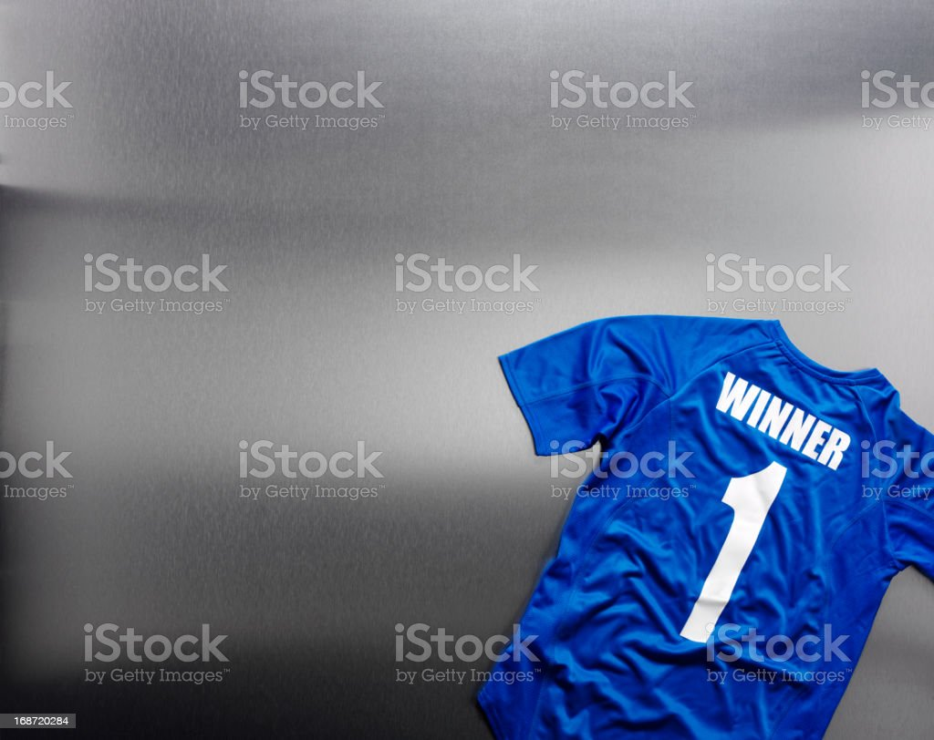 Winner on a Royal Blue Football Shirt royalty-free stock photo