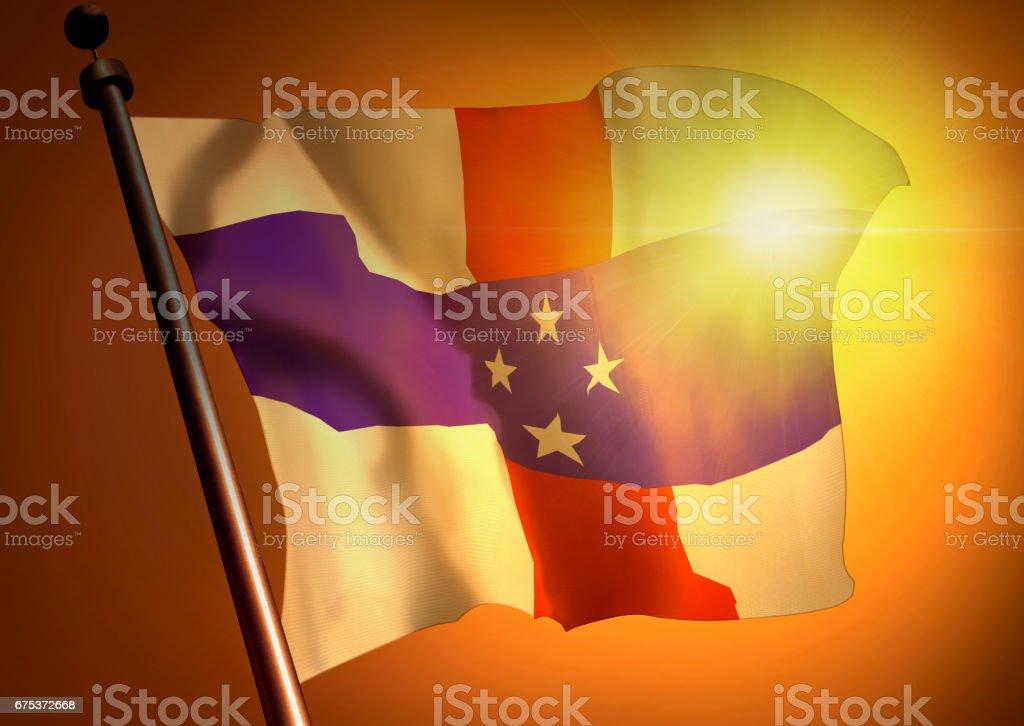 winner waving Netherlands Antilles flag against the sunset stock photo