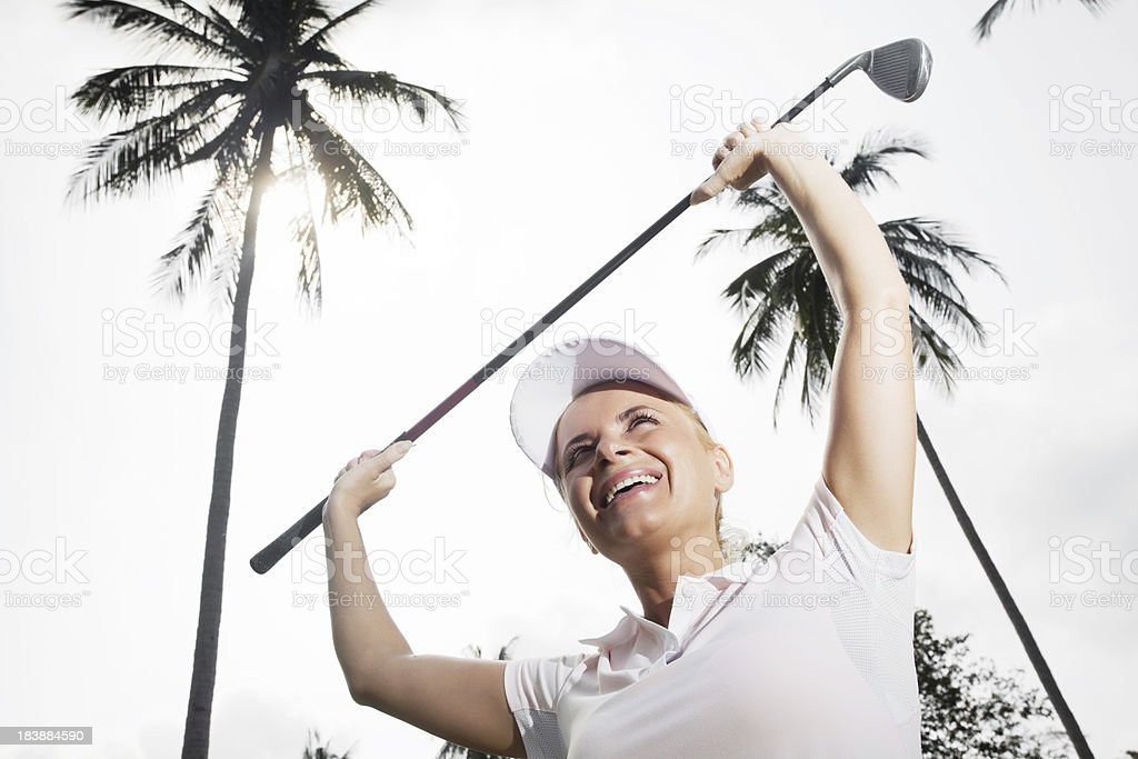 Winner woman with golf stick. stock photo