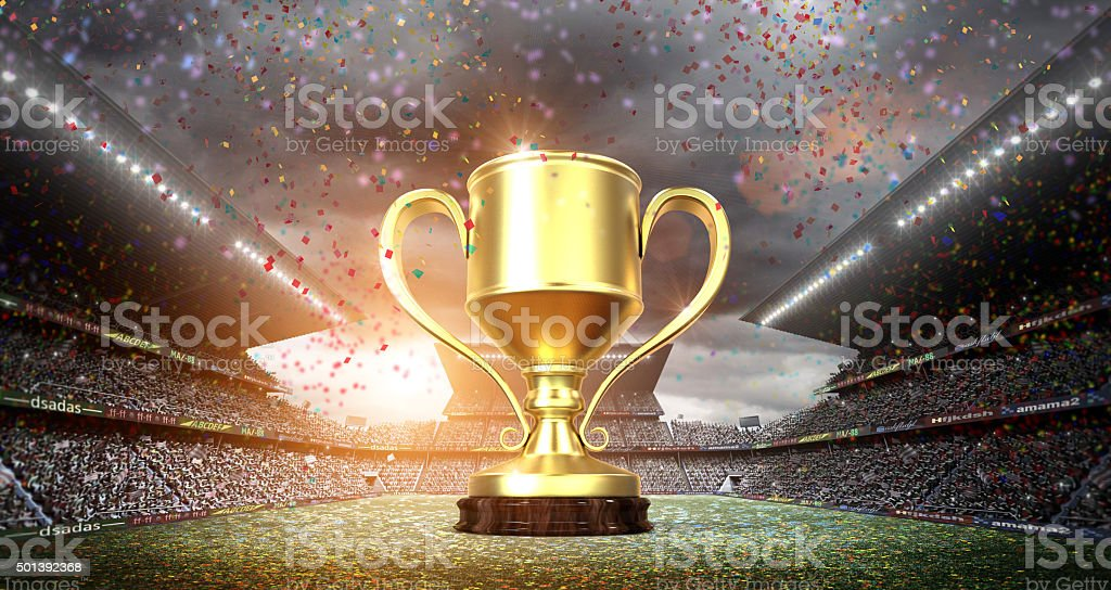 winners cup in the stadium stock photo