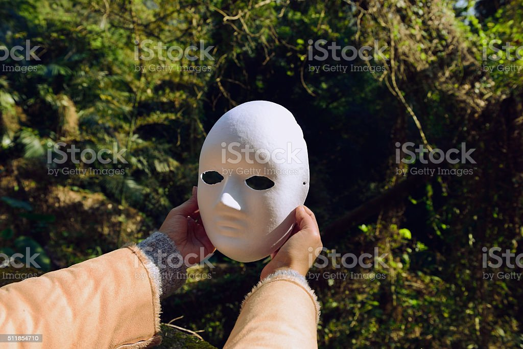 Winners do not need to hide behind a mask stock photo