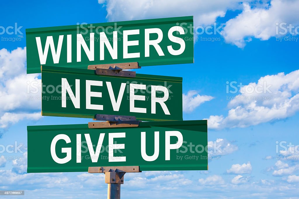 Winners Never Give UP Street Sign stock photo