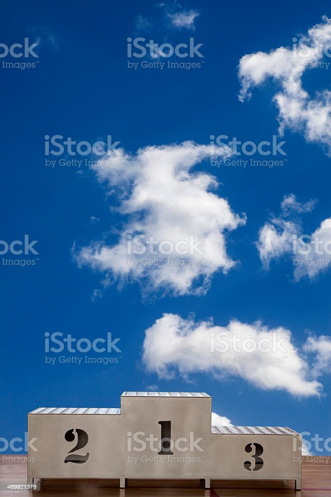 Winners podium with numerals on the sky - Stock Image stock photo