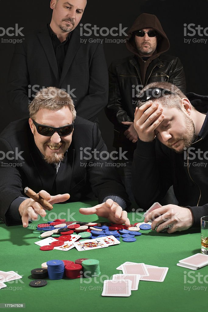 Winning and losing card players stock photo