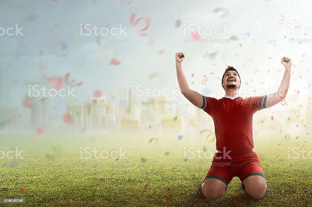 Winning football player stock photo