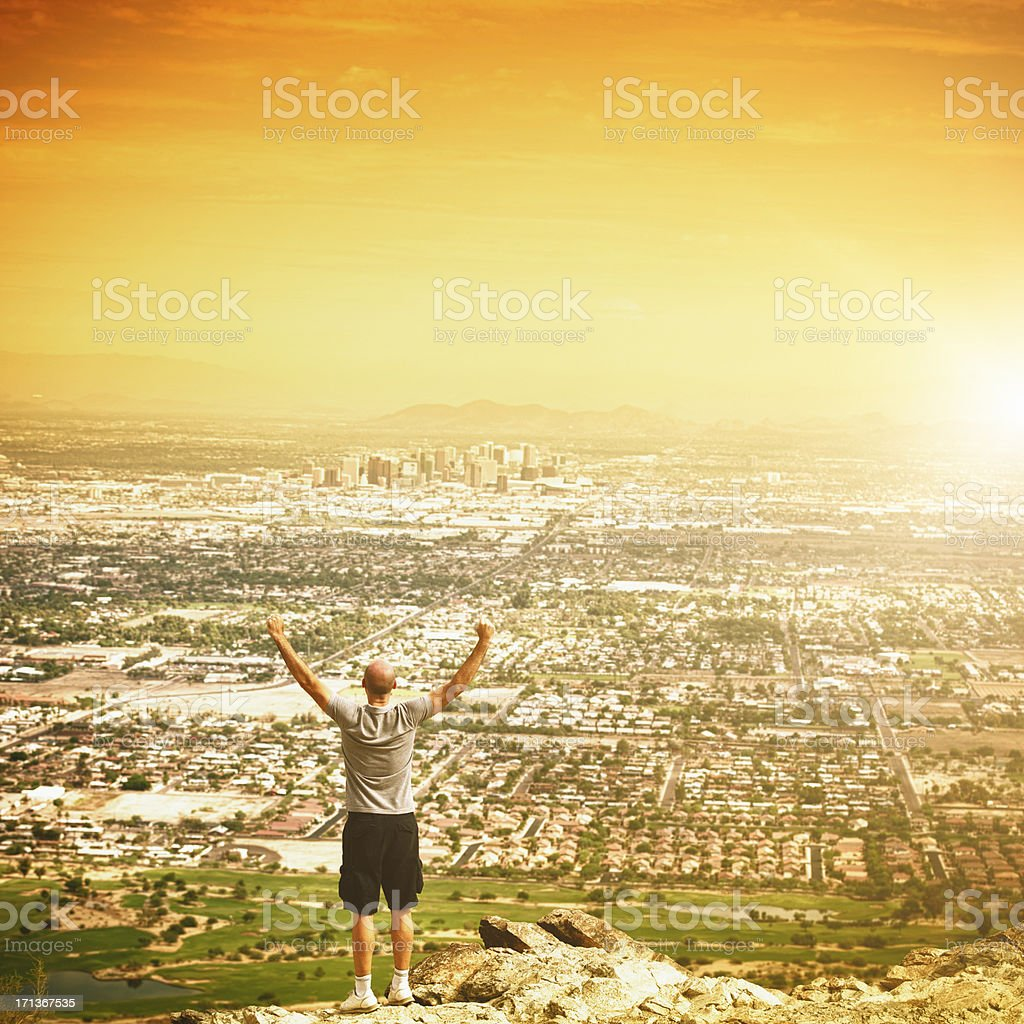 Winning man after hiking on Phoenix city royalty-free stock photo