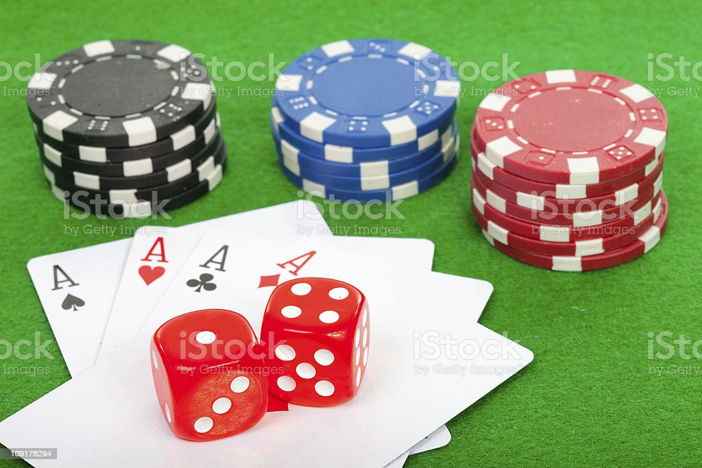 winning poker hand of four aces playing cards and chips stock photo