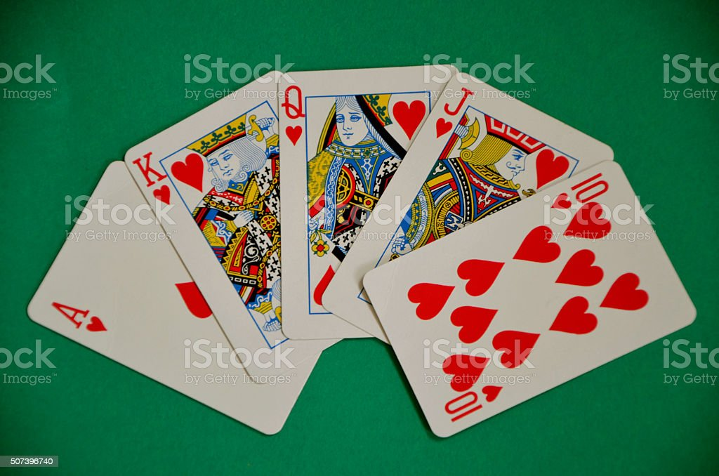 Winning Poker Royal Flush Hand on Green Baize stock photo