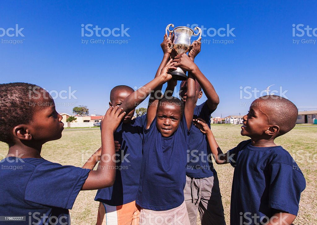Winning team lifting trophy, Gugulethu, Cape Town, South Africa royalty-free stock photo