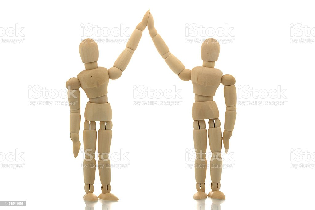 Winning Team. Manikins shaking hands. royalty-free stock photo