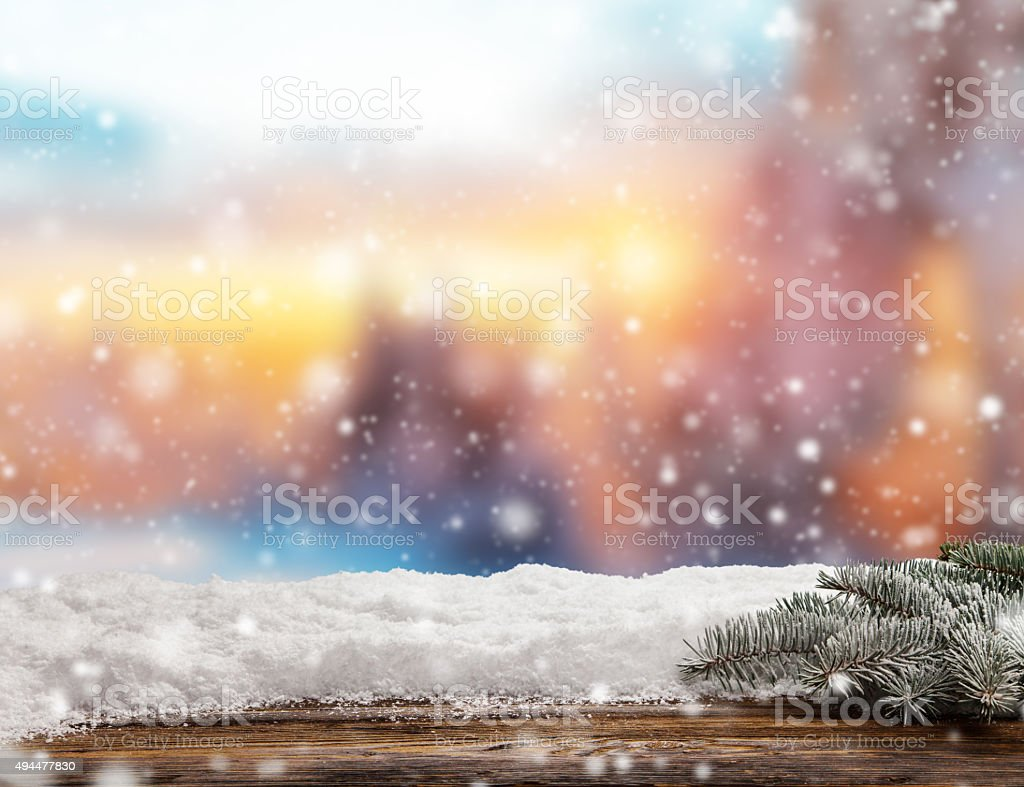 Winter background with pile of snow and blur evening landscape. Empty...