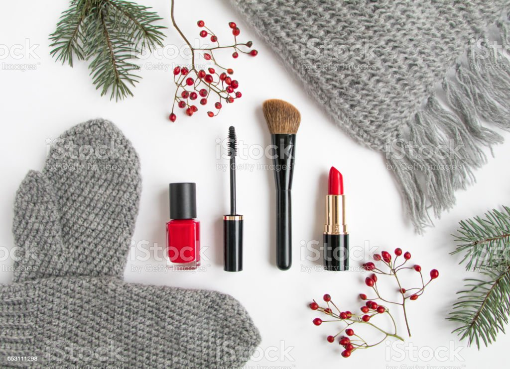 Winter accessories collage with cosmetics and clothes on white background. Flat lay, top view stock photo