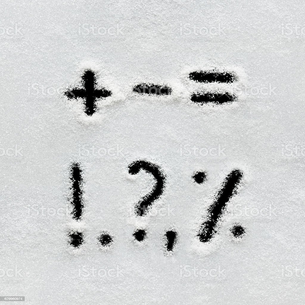 Winter alphabet, symbols and numbers hand written on snow. stock photo
