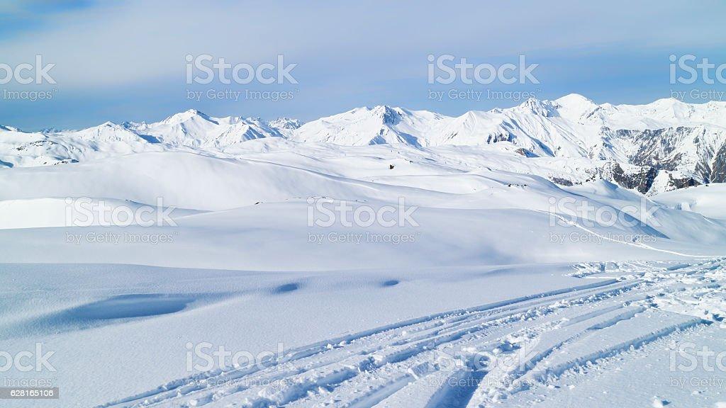 Winter Alps scenery with ski marks stock photo