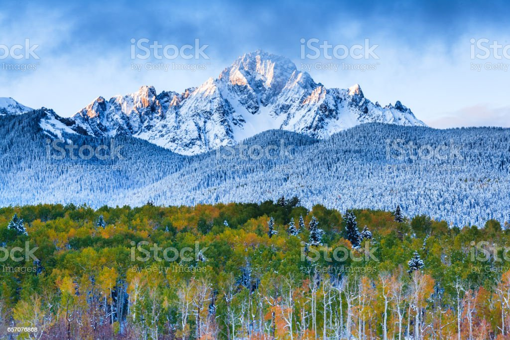 Winter and Autumn Collide in the San Juan Mountains of Colorado stock photo