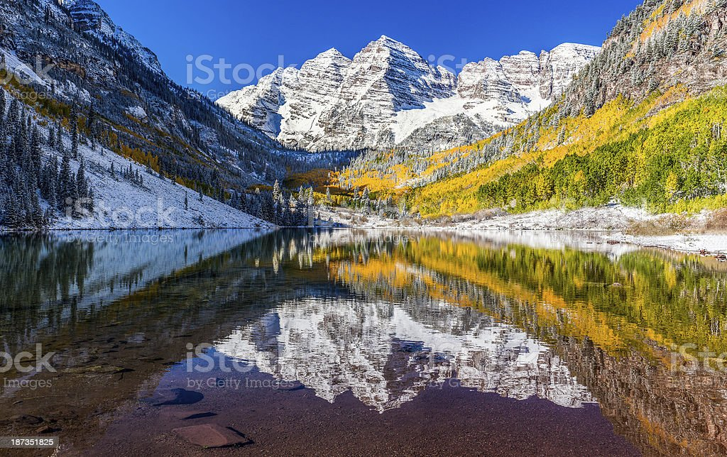 winter and Fall foliage in Maroon Bells, Aspen, CO stock photo