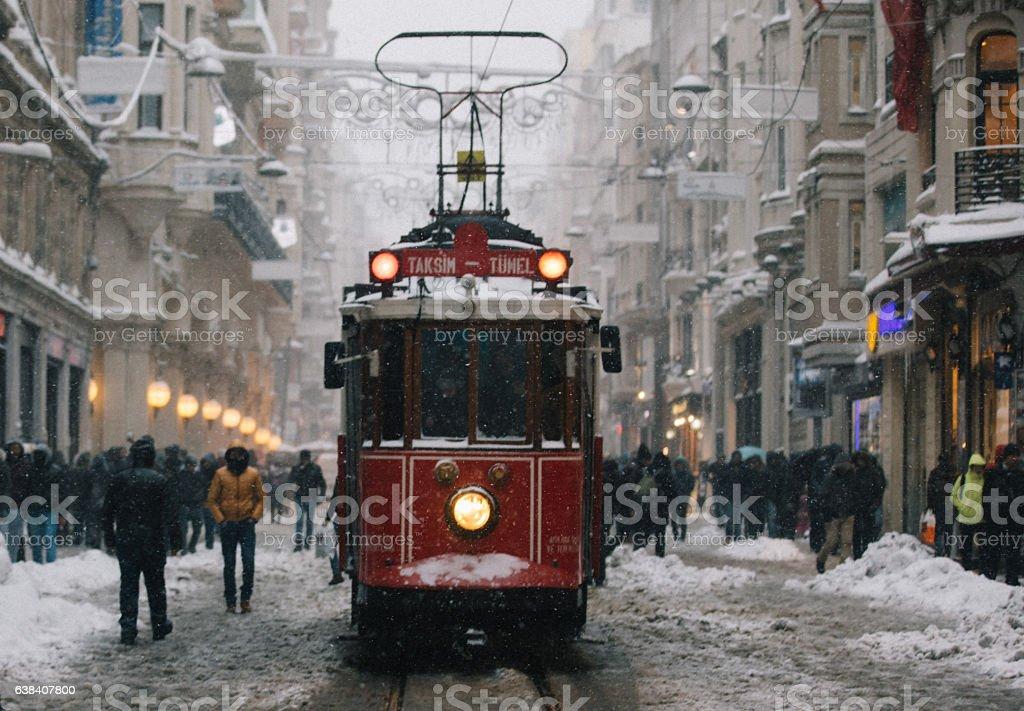 Winter and Red Tram in Istiklal Street, Beyoglu, Istanbul. stock photo