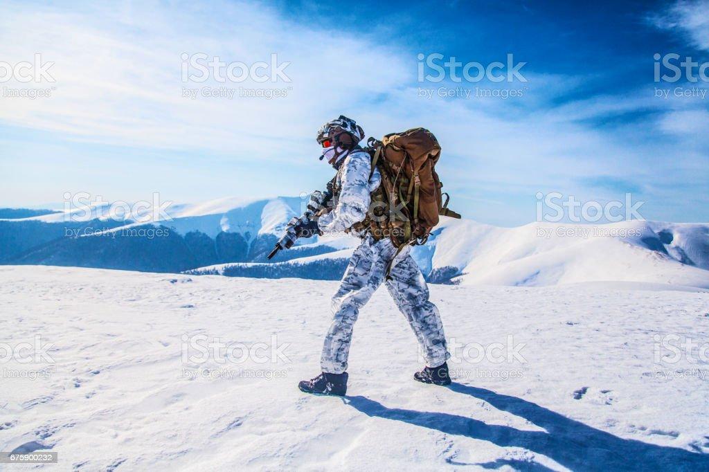 Winter arctic mountains warfare stock photo