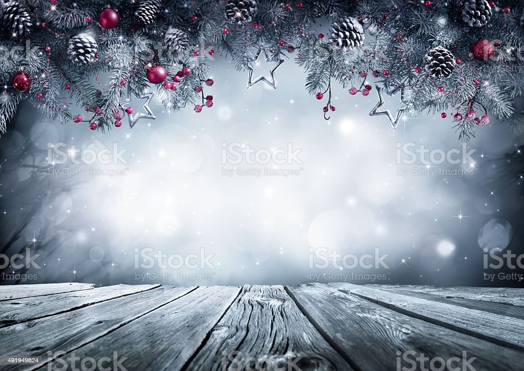 Winter background with frost fir branch and wooden planks stock photo