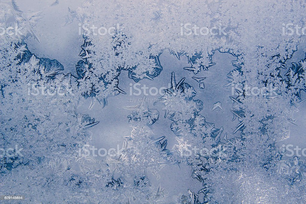 Winter background with icy frost patterns on the window. stock photo