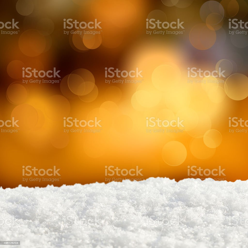 Winter background.Abstract bokeh lights and snowdrift stock photo
