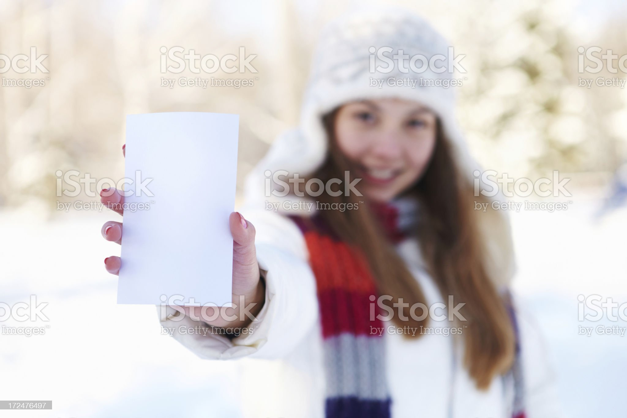 Winter. Beautiful girl with blank white banner. royalty-free stock photo