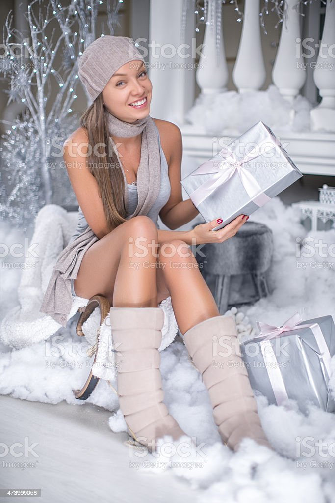 Winter beauty holding a Christmas present stock photo