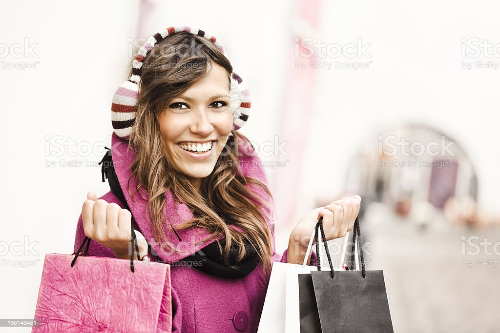 Winter beauty with shopping bags royalty-free stock photo