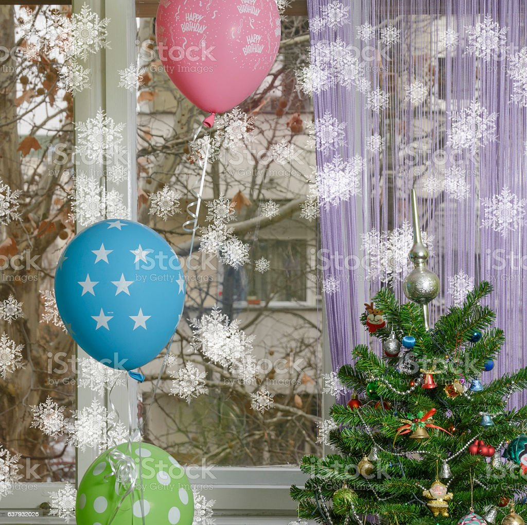 Winter birthday! Christmas tree with balloons and snowflakes. stock photo
