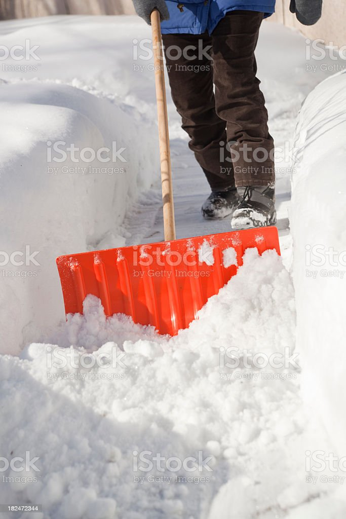 Winter Blizzard Storm Snow on Sidewalk Removal by Snow Shovel royalty-free stock photo