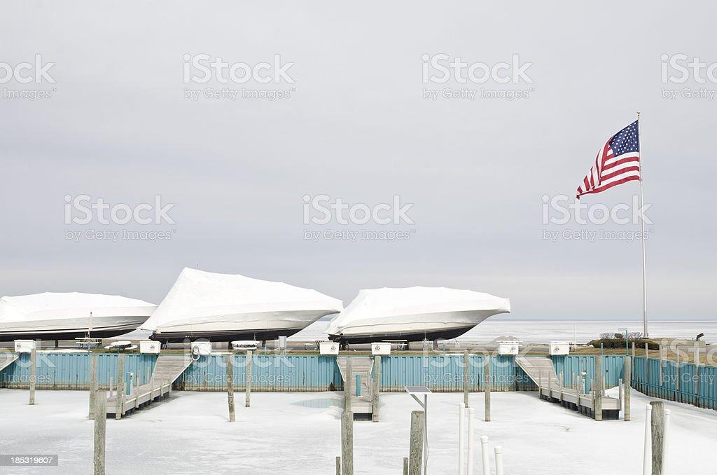 Winter boat storage at dock stock photo