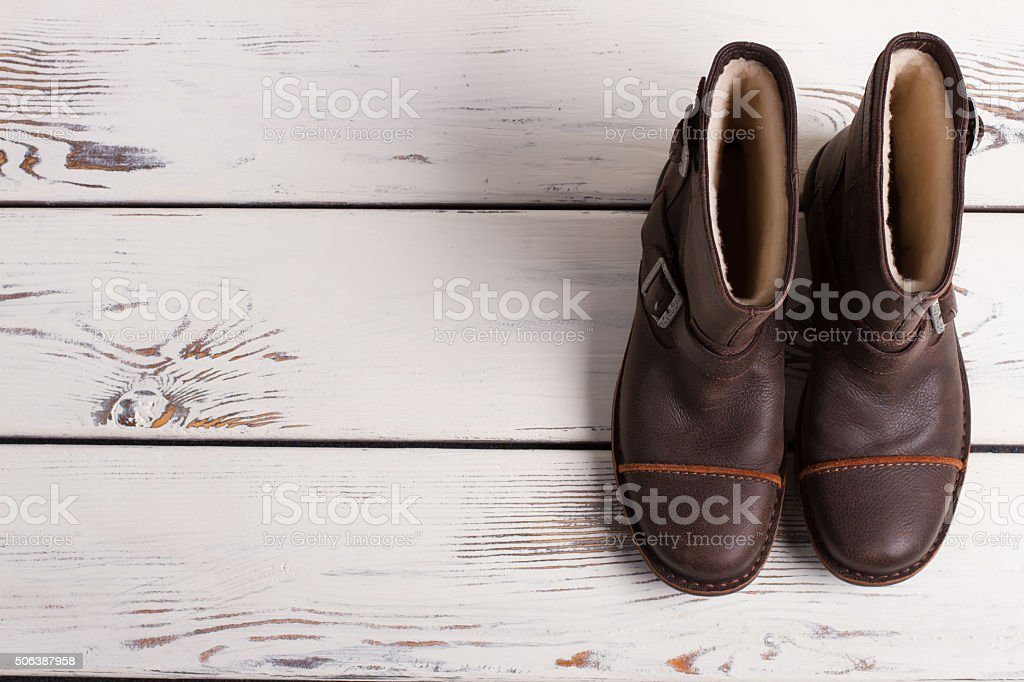 Winter boots on a wooden boards. stock photo