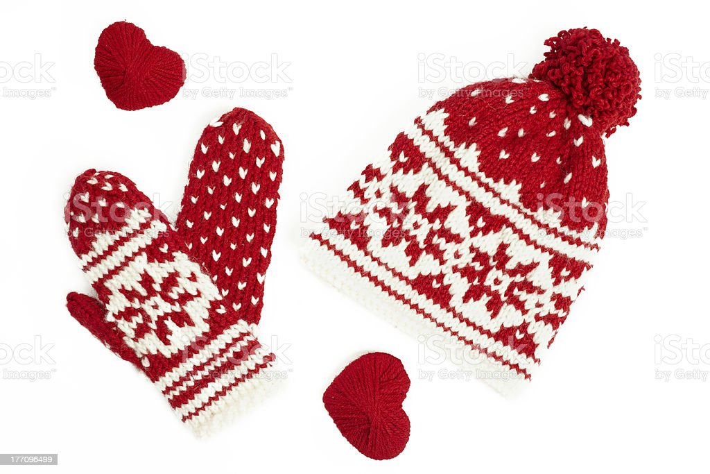 winter cap and mittens knitted with jackard motifs. on white stock photo