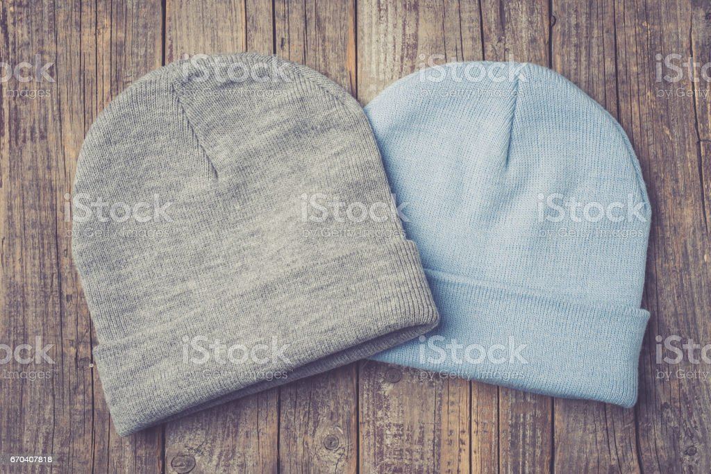 Winter caps on an old wooden table. stock photo