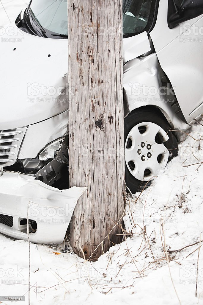 Winter Car Accident Vehicle Slid Off Road into Electric Pole stock photo