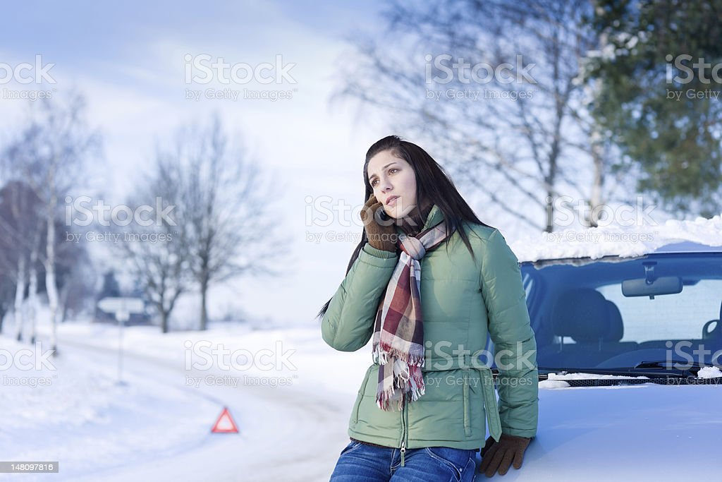 Winter car breakdown - woman call for help stock photo