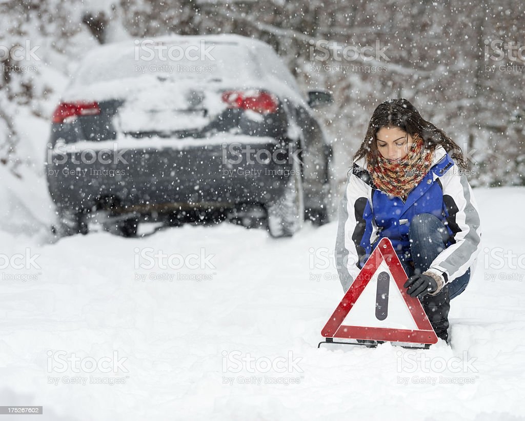 Winter Car Breakdown, Woman Warning Triangle, Snowstorm royalty-free stock photo