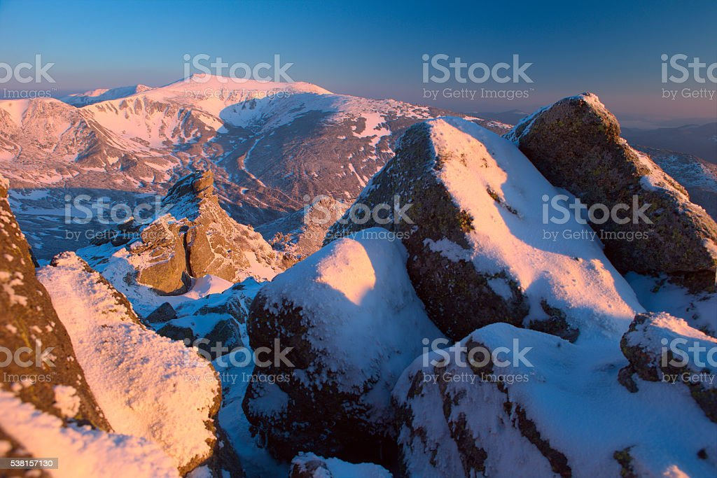 Winter Carpathian mountains; rock and a morning light stock photo