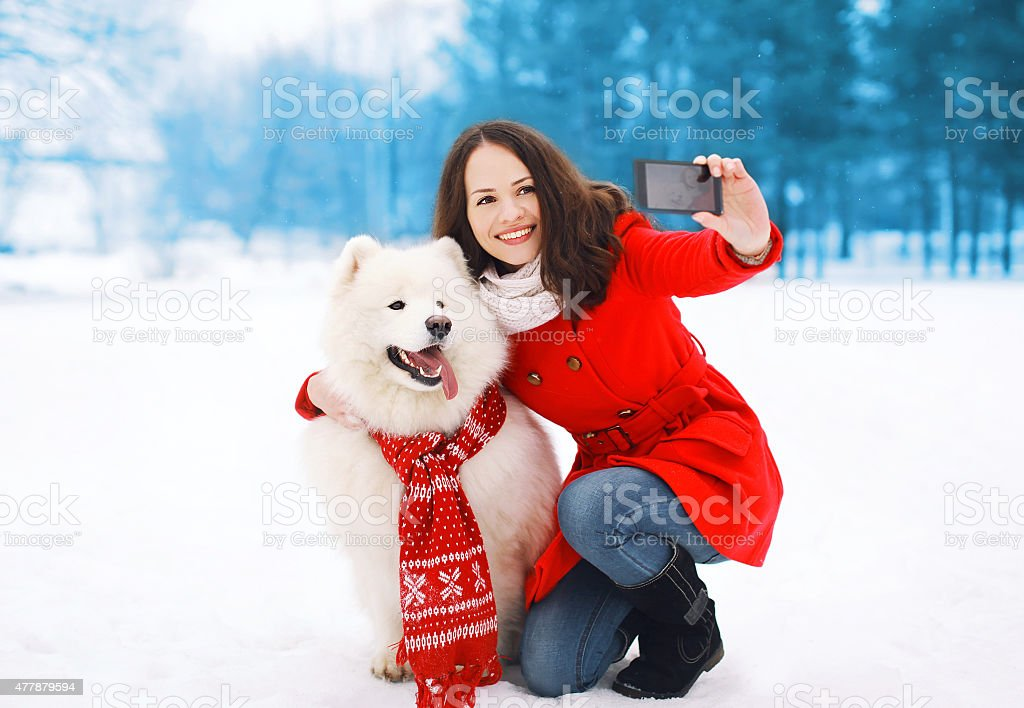 Winter, christmas, technology and people concept - happy woman a stock photo