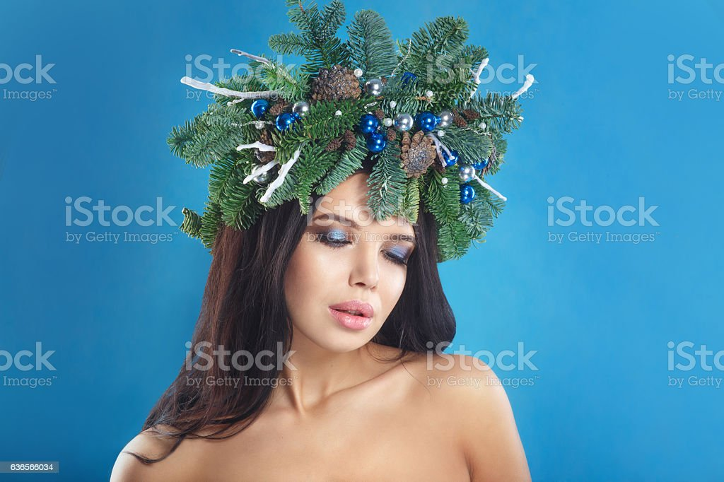 Winter Christmas Woman. Beautiful New Year and Christmas Tree Ho stock photo