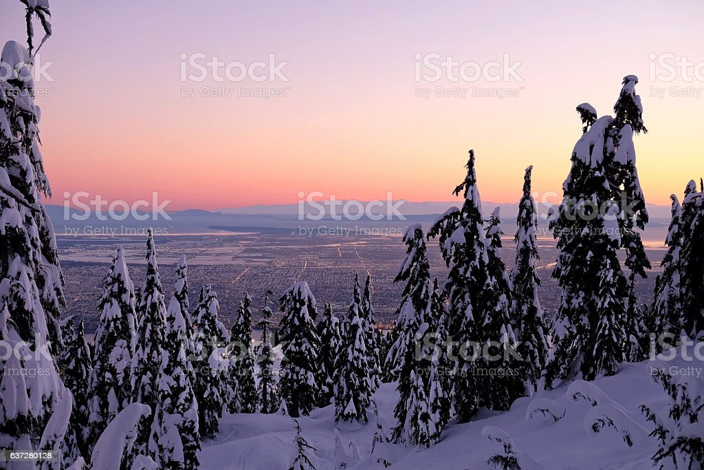 Winter city view from mountain in sunrise. stock photo