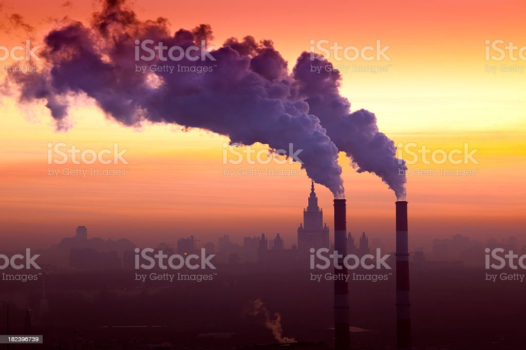 Winter cityscape with steam emissions and industrial pollution stock photo