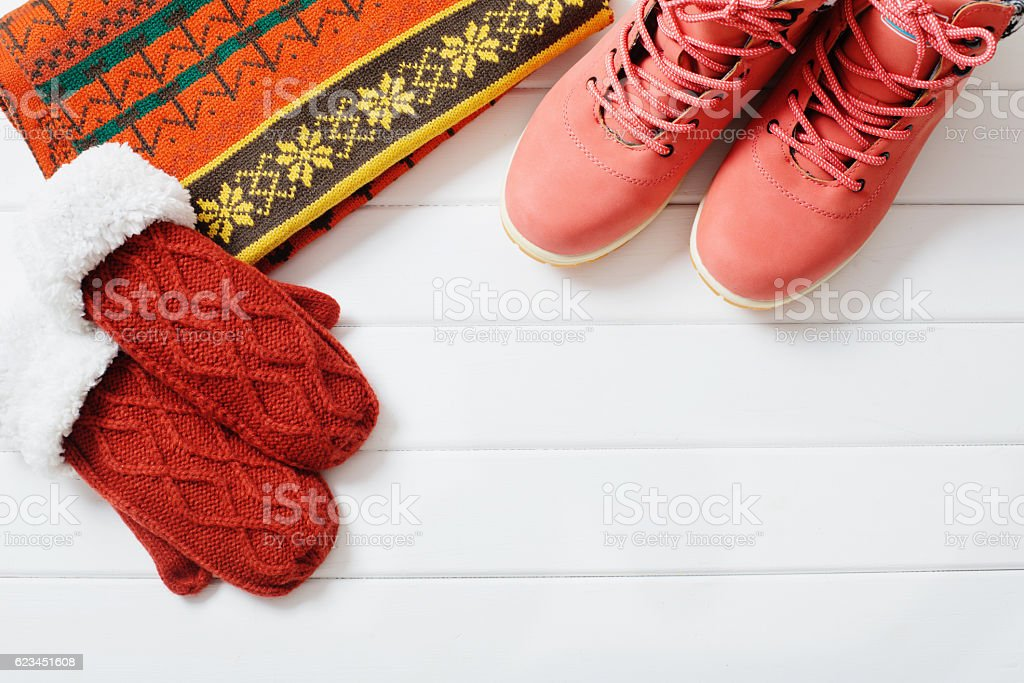winter clothes and shoes on a wooden background stock photo