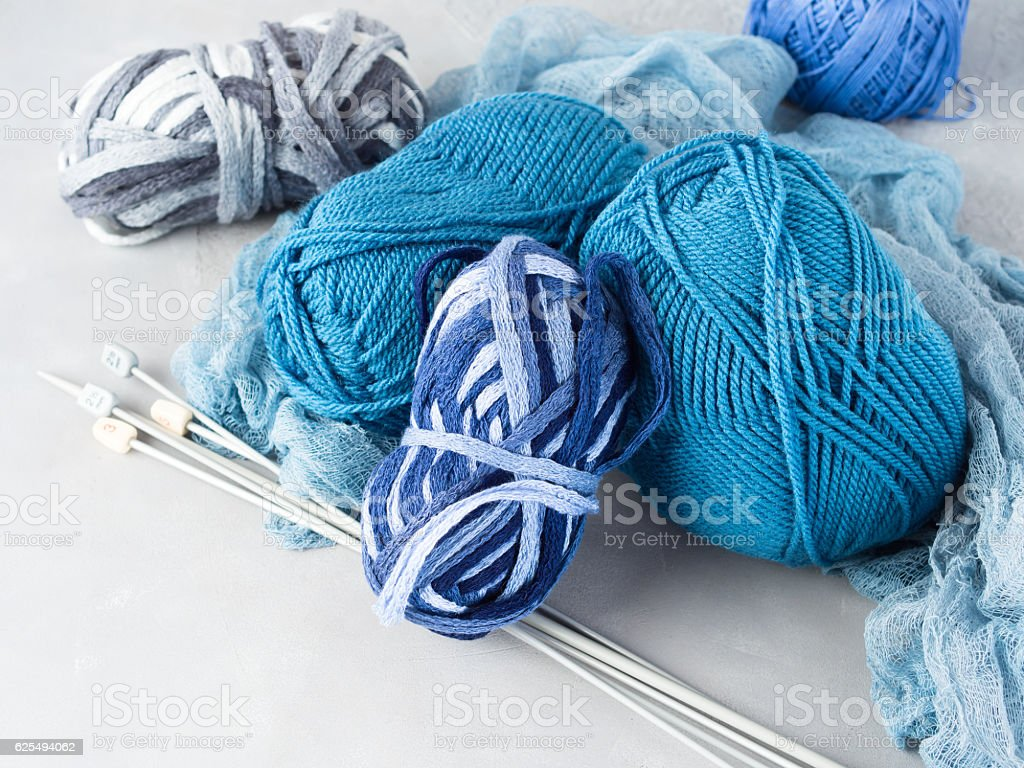Winter cold color woolen yarn with knitting needles stock photo